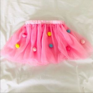 Adorable tull pink tutu with colored pom poms
